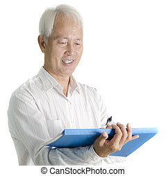 Asian senior businessman writing on document