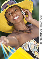 African American Woman With Fashion Shopping Bags on Cell...