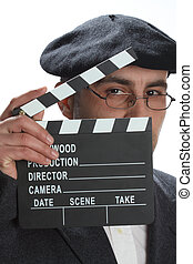 movie clapboard - Old fashioned man looking through the...