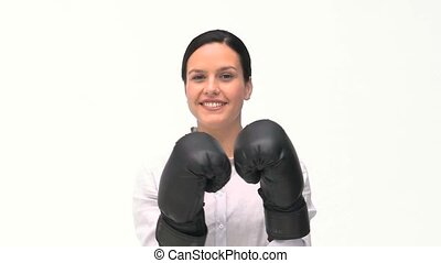 Beautiful woman with black boxing gloves agaisnt a white...