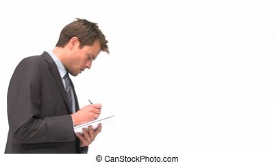 Businessman writing on his notepad against a white...