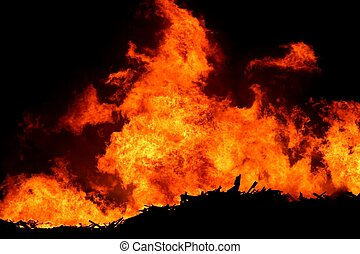 Huge Fire - A huge fire with bright orange flames and...