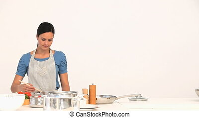 Woman preparing sauce for lunch - Woman preparing sauce for...
