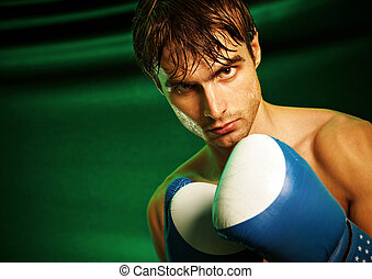 Man sweating all over in boxing gloves