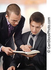 Showing a truth - Young man showing a truth in the Bible, to...