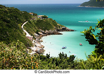 Boats over a crystalline turquoise sea in Arraial do Cabo,...