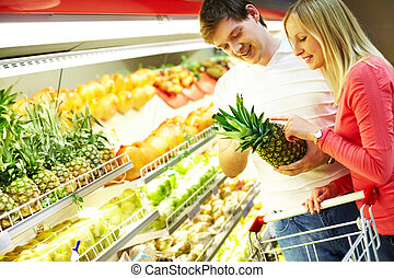 Looking at products - Portrait of healthy couple looking at...