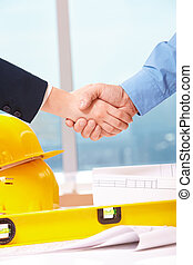 Deal - Close-up of workers doing handshake