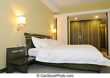 Hotel bedroom - Nicely decorated hotel bedroom in the...