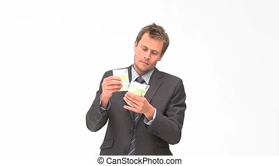 Businessman counting euro bills