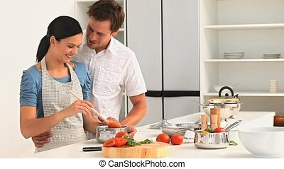 Couple preparing sauce for lunch in the kitchen