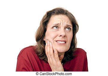 woman with toothaches holding her jaw
