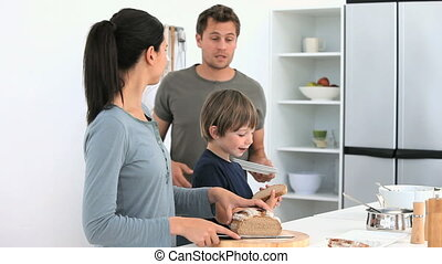 Family preparing the lunch in the kitchen