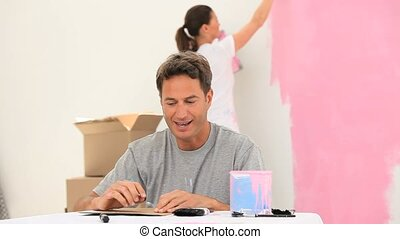 Couple doing painting work in a room