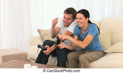 Couple playing video games in the livingroom