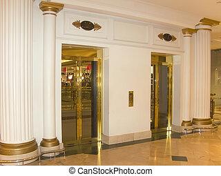 Vintage elevators - White marble vintage elevators, in...