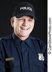 Jovial Policeman - Portrait of a friendly, laughing...