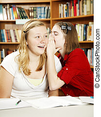 Secrets in Class - Teen girls whispering and telling secrets...