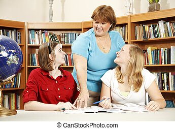 Librarian and Teen Students - Librarian helps too teenage...