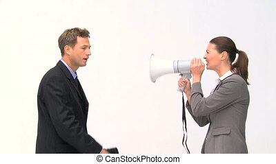 Businesswoman shouting through a megaphone against a white...