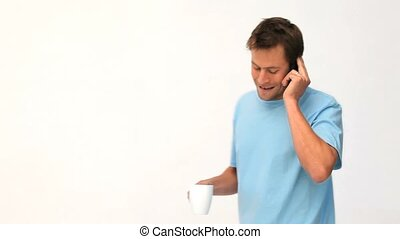 Man talking on the phone during a coffee break - Woman...