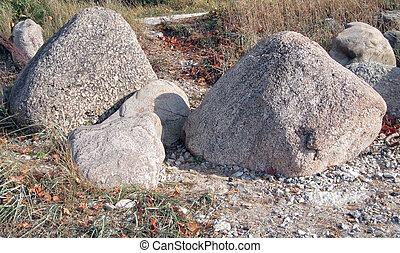 Marine boulgers - Marine boulders on the beach,causing...