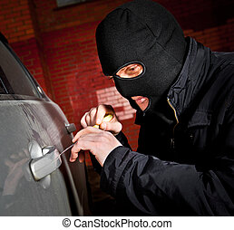 robber and the thief in a mask hijacks the car