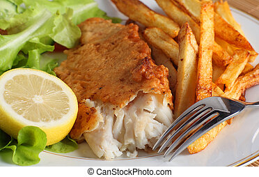 Fish, fries and salad - A dinner of fish and chips or french...