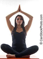 Attractive twenties hispanic woman doing yoga exercise