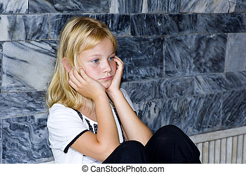 blond girl with bad mood - blond preteen with a bad mood...