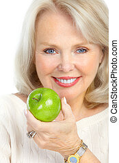 woman - Mature smiling woman with a green apple
