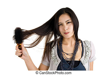 woman brushing her hair - pretty woman brushing her long...