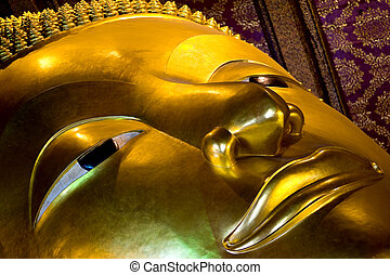 close up of the reclining buddha - close up of the famous...