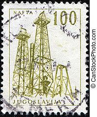 oil derrick - YUGOSLAVIA - CIRCA 1958: A stamp printed in...