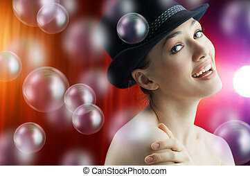 Soap bubbles - a very beautiful girl behind the coulisses