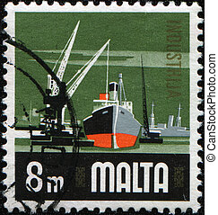 cargo port - MALTA - CIRCA 1968: A stamp printed in Malta...