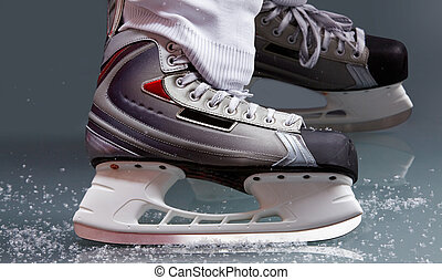 Skating - Close-up of skates on player feet during ice...