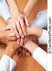 Friendship - Image of business partners hands on top of each...