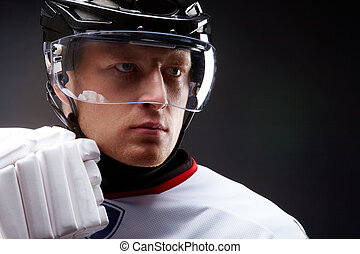 Serious player - Face of sportsman in protective helmet over...
