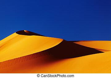 Sand dune in Sahara Desert at sunset, Algeria