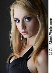 Little black dress - Young adult caucasian woman with blonde...