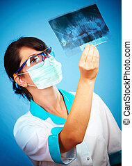 Doctor with xray - female doctor with jaw xray