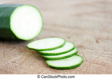 Courgettes on a wooden background