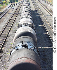 The train transports oil in tanks . - Tanks with oil stand...