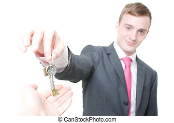 Keys - A business man giving you the keys to a home