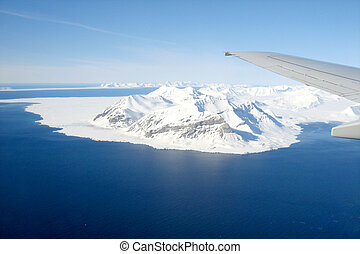 Global warming illustrated by wing and glaciers