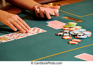 Casino hands - People are playing cards in casino, close up...