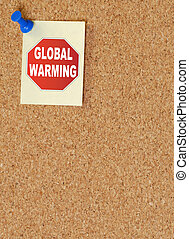 note with stop global warming posted on corkboard