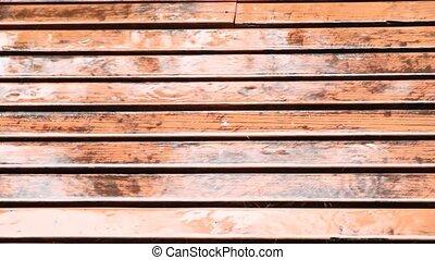 Rain falling on Planks