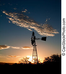 Silhouette of a Windmill at sunset in the Karoo